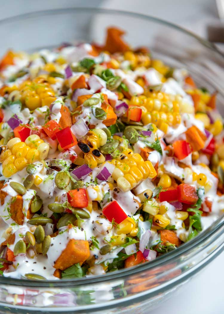 close up of Sweet Potato and Corn Salad in glass bowl