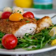 This easy to make Chicken Milanese starts with butterflied chicken breasts that are lightly breaded and pan fried to a golden brown. I plate on a bed of dressed arugula greens and top with mozzarella and tomatoes for a quick, delicious lunch or dinner.
