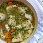 This beautifully seasoned Southern Chicken and Dumplings is made with shredded chicken, vegetables and is loaded with tender herb and buttermilk dumplings.