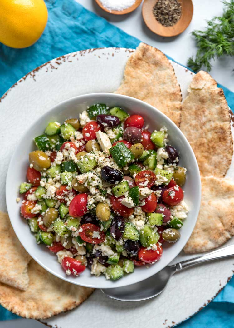 overhead photo of Greek Salad with Feta in white bowl