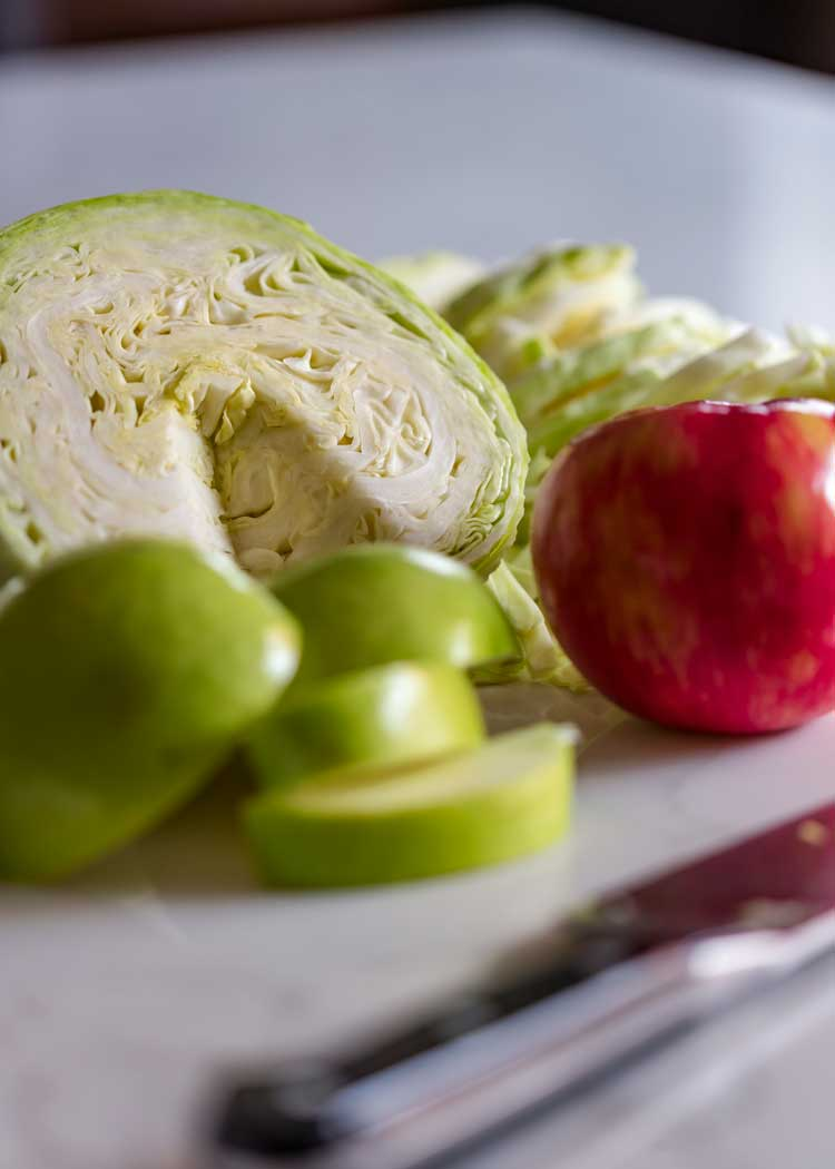 angle shot of cabbage and sliced apples