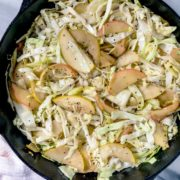 braised cabbage and apple in white casserole dish