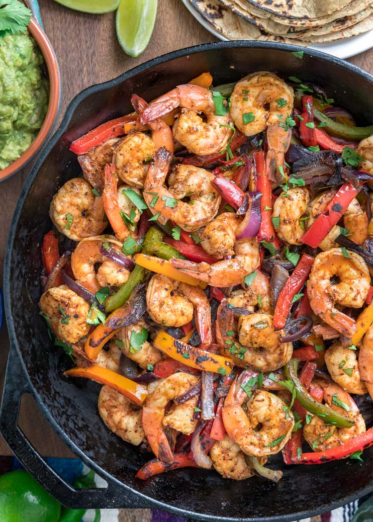 overhead shot of skillet with shrimp fajitas