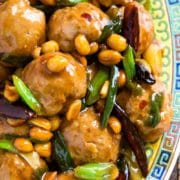 These Kung Pao Chicken Meatballs are made with peanut butter and chili paste, get baked and then coated in a wonderfully authentic pan sauce with green onions, chilis and peanuts.
