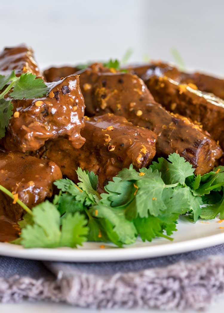 platter of Orange Braised Beef Short Ribs with cilantro