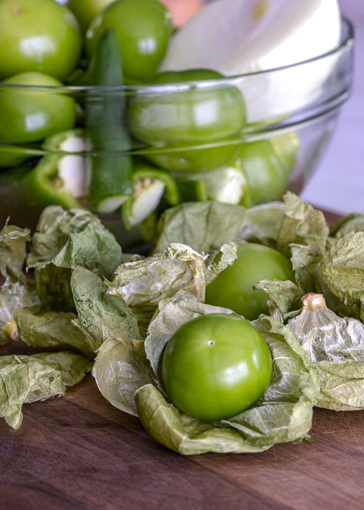 tomatillos and chiles in a glass bowl