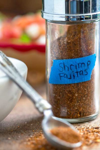Shrimp Fajitas Seasoning Blend bottle and spoon
