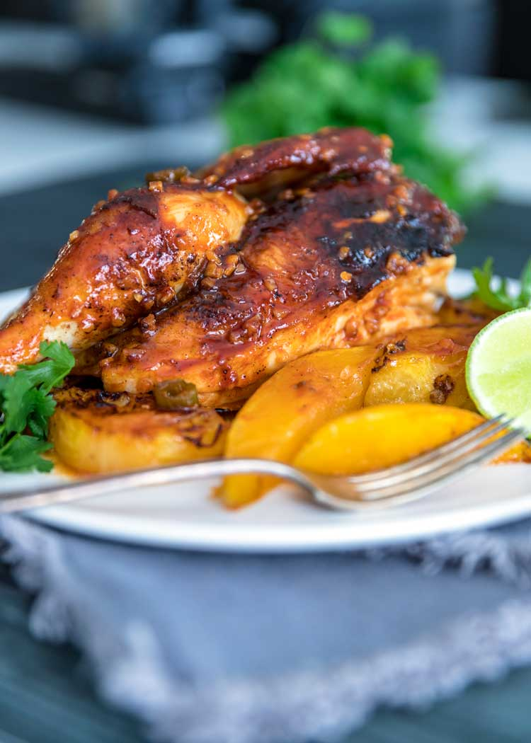plate of Tropical Roasted Chicken on grey napkin