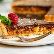This Chocolate Macadamia Nut Tart has a buttery pastry shell filled with macadamia nuts, a caramel filling studded with chunks of ginger all topped with a chocolate ganache.