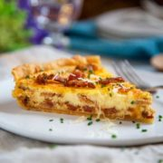 slice of Quiche Lorraine on a white plate