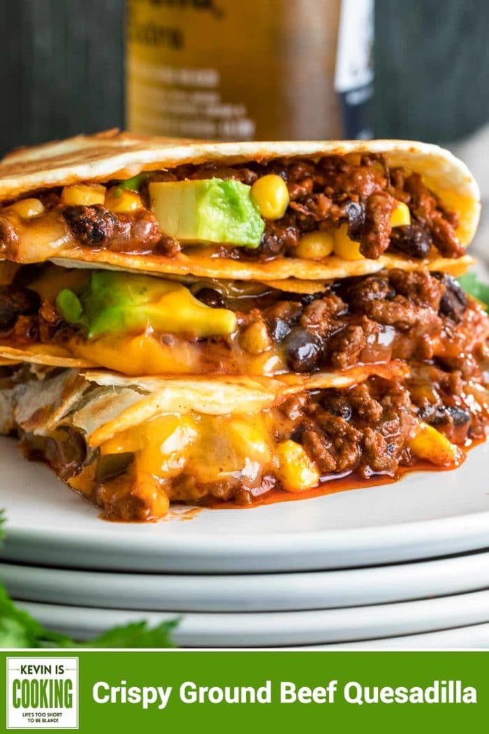 stack of Crispy Ground Beef Quesadilla on white plate with beer