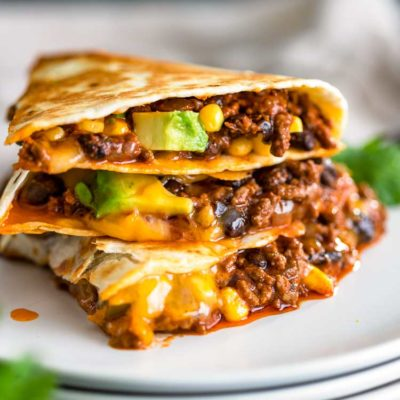 stack of sliced Crispy Ground Beef Quesadilla
