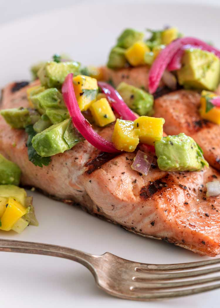 close up of Grilled Salmon with Avocado Salsa with fork