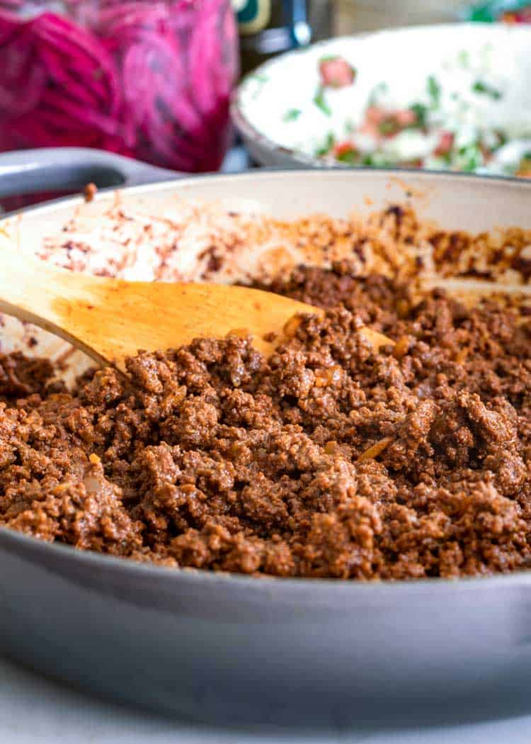 skillet of ground beef with spices for Easy Ground Beef Tacos