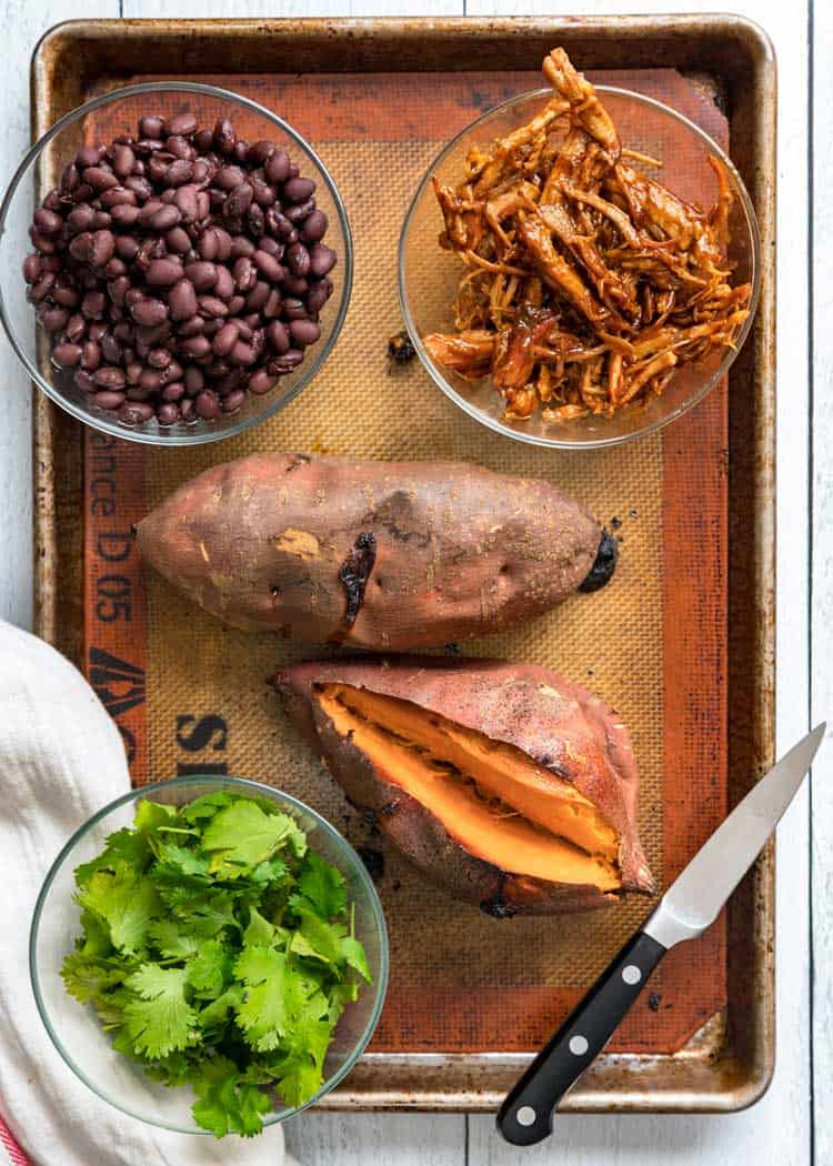 overhead of ingredients for Pulled Pork Stuffed Sweet Potatoes