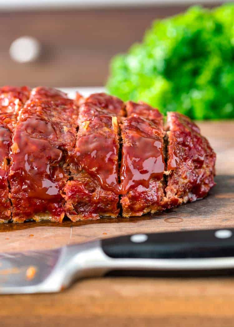 BBQ Smoked Meatloaf slice on wood cutting board