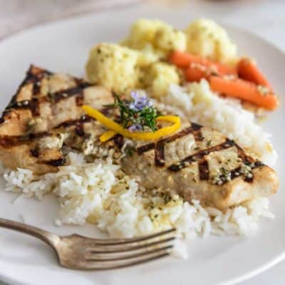 close up of Lemon Rosemary Grilled Swordfish on white plate