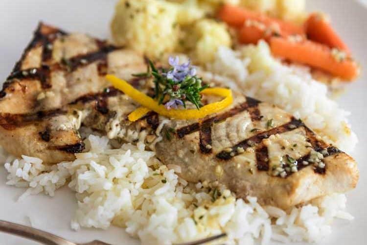 close up of Lemon Rosemary Grilled Swordfish on white plate