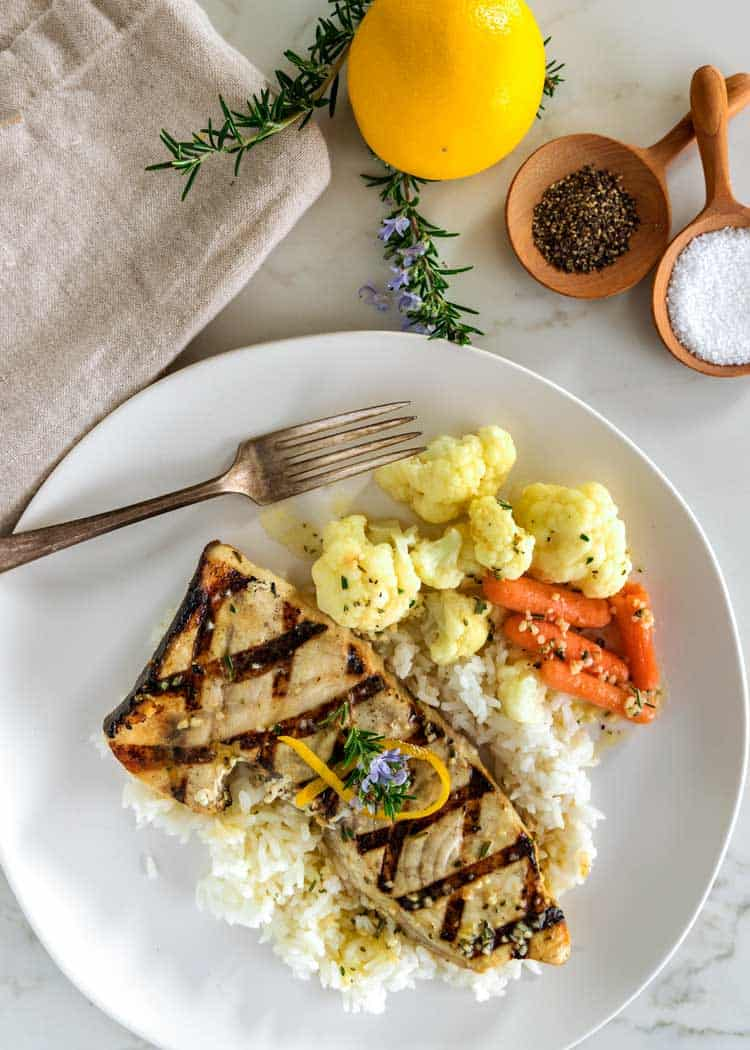 overhead shot of plate of Lemon Rosemary Grilled Swordfish with rice and vegetables