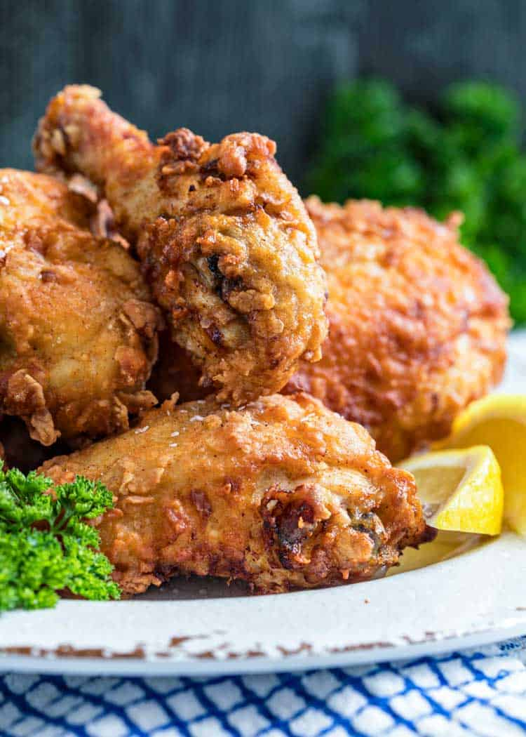 plate of The Best Southern Fried Chicken with lemon and parsley