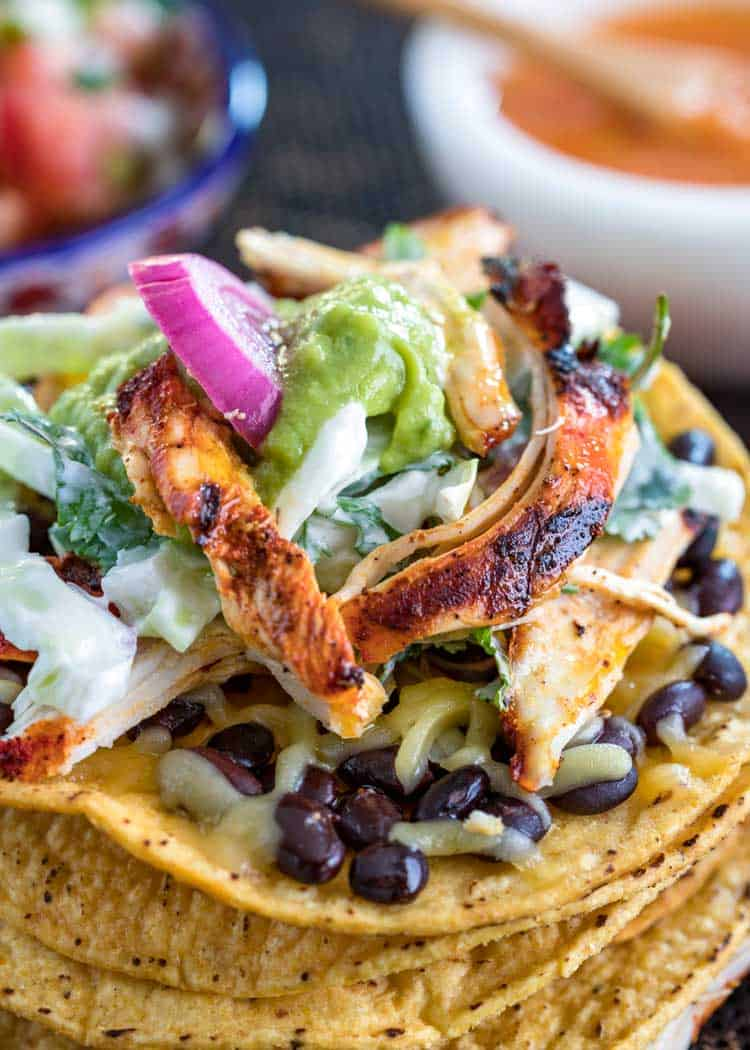 marinated chicken on stack of tostada shells