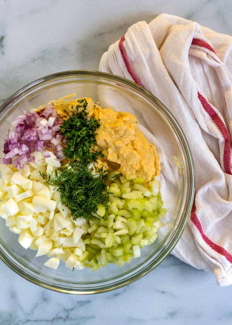 overhead photo of bowl of Classic Egg Salad ingredients