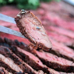 piece of tender flank Steak on fork