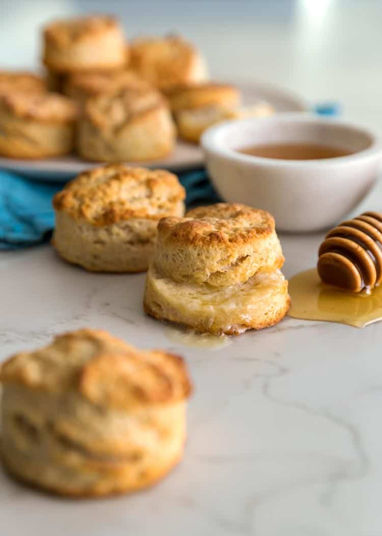 prep photos how to make Southern Buttermilk Biscuits on white marble with honey