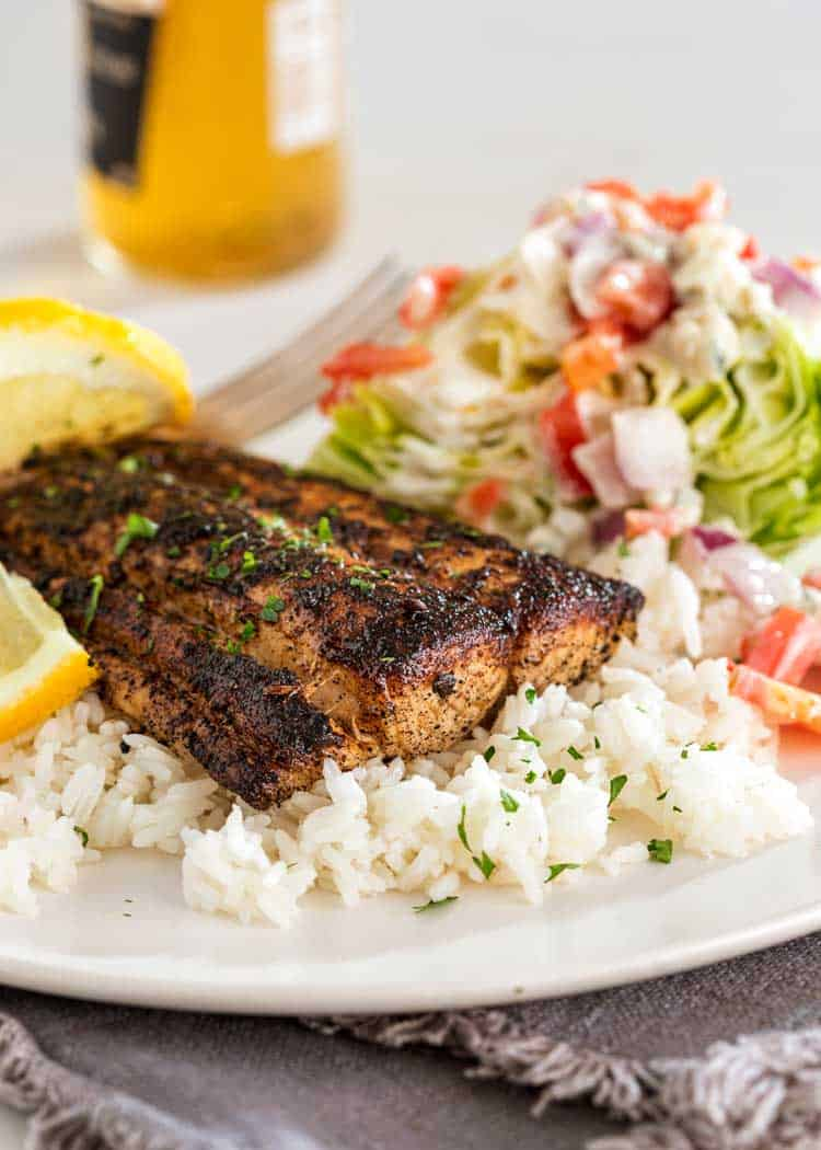 Blackened Mahi Mahi on plate with rice and beer in background