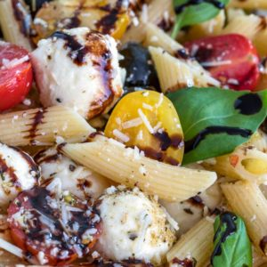 A pile of herbs, cheese Pasta Salad