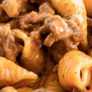 ground beef in cheesy sauce with shell pasta