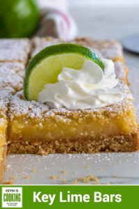 close up of a Key Lime Bars with whipped cream and a lime slice