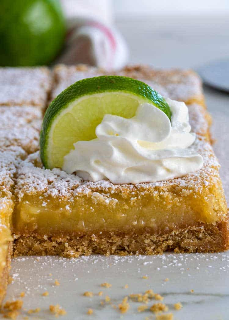 key lime bar with whipped cream an dlime slice