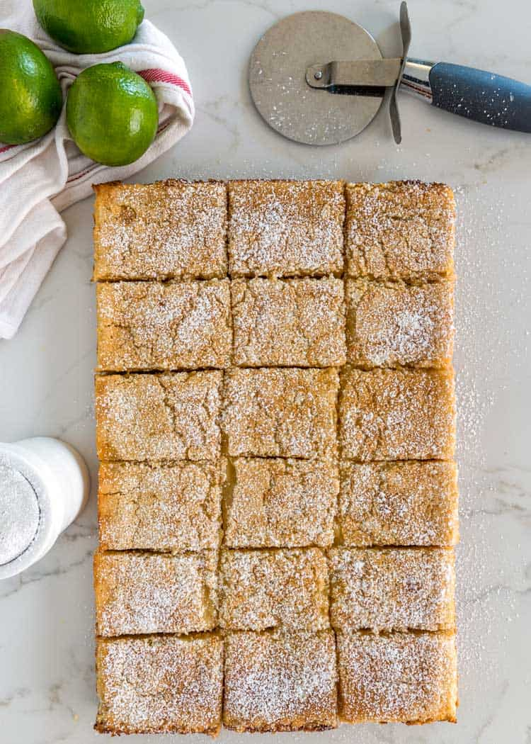 overhead shot of key lime bars with powdered sugar