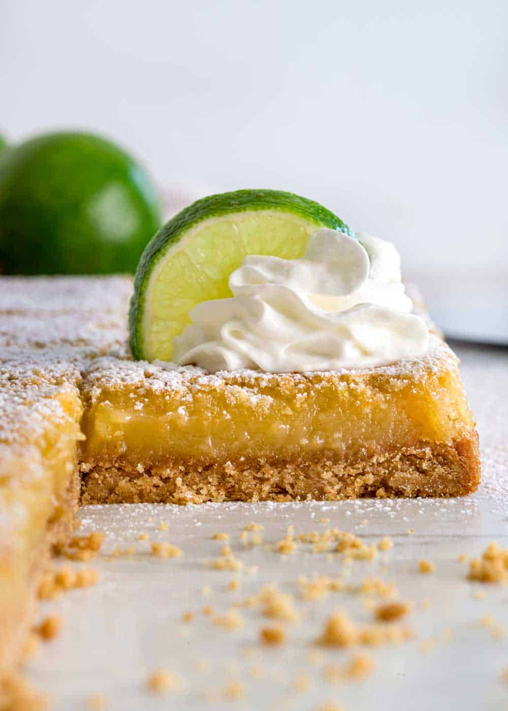 Key Lime Bar slice don white marble with crumbs