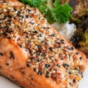 Pan Seared Everything Salmon on white plate with rice and vegetable