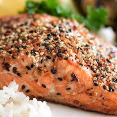 close up of Pan Seared Everything Salmon on white plate with rice and vegetable