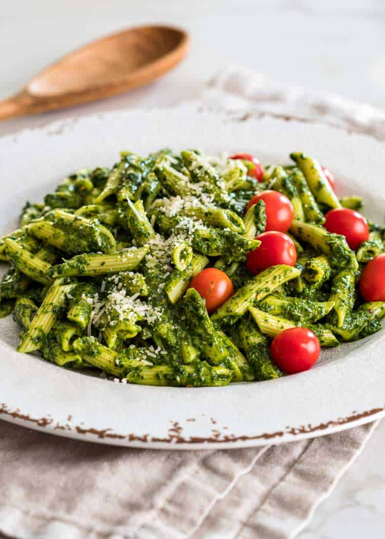 Sauce Verde Pasta with red tomatoes