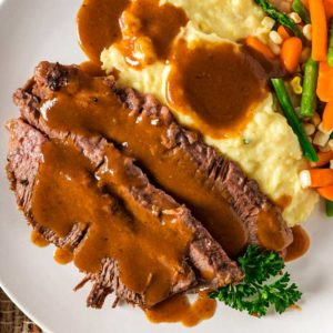 slices of Yankee Pot Roast and gravy and vegetables