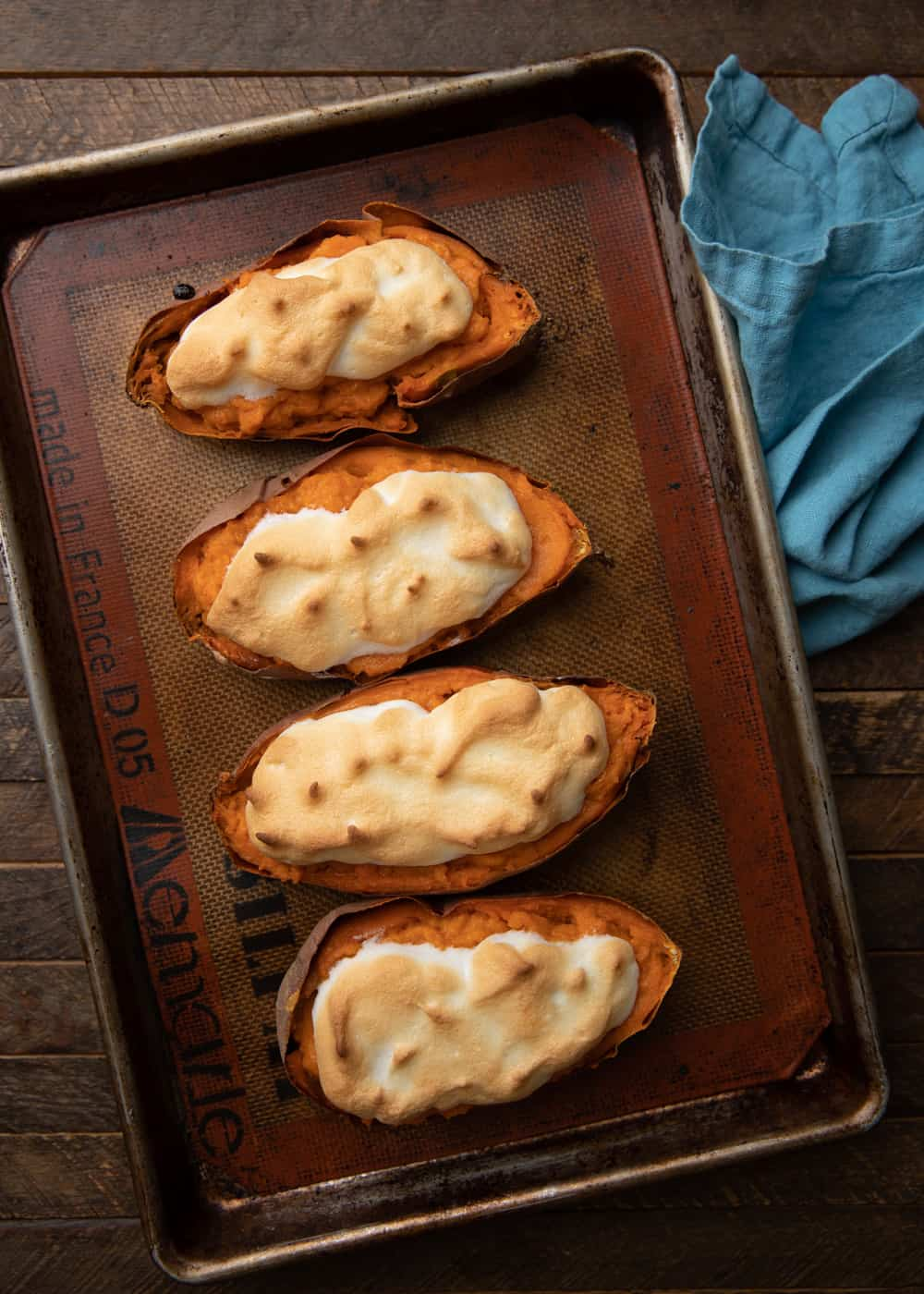 baked sweet potatoes topped with meringue