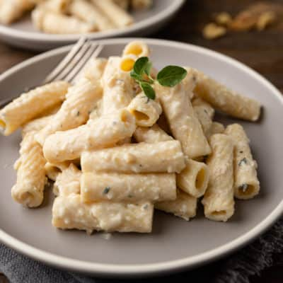 white pesto pasta on grey plate
