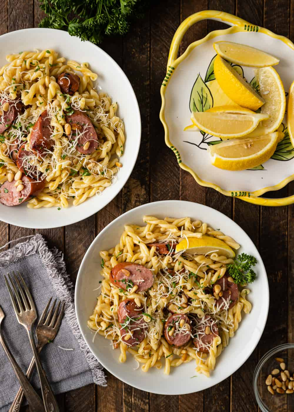 plates of Smoked Sausage and Browned Butter Pasta with lemons