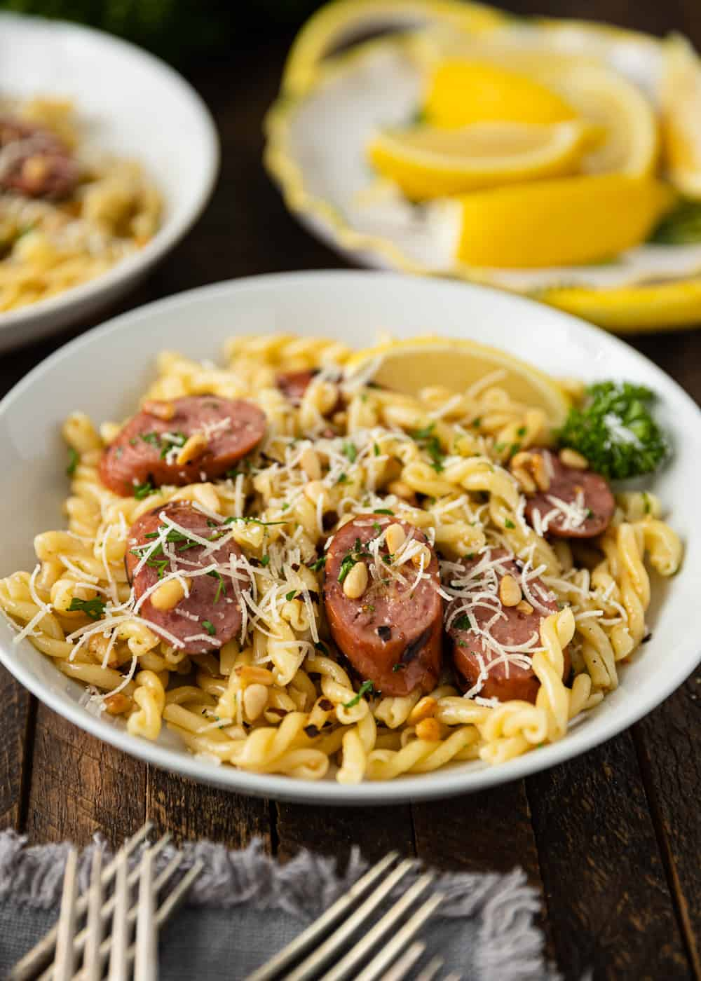 plate of Smoked Sausage and Browned Butter Pasta with parmesan cheese on top