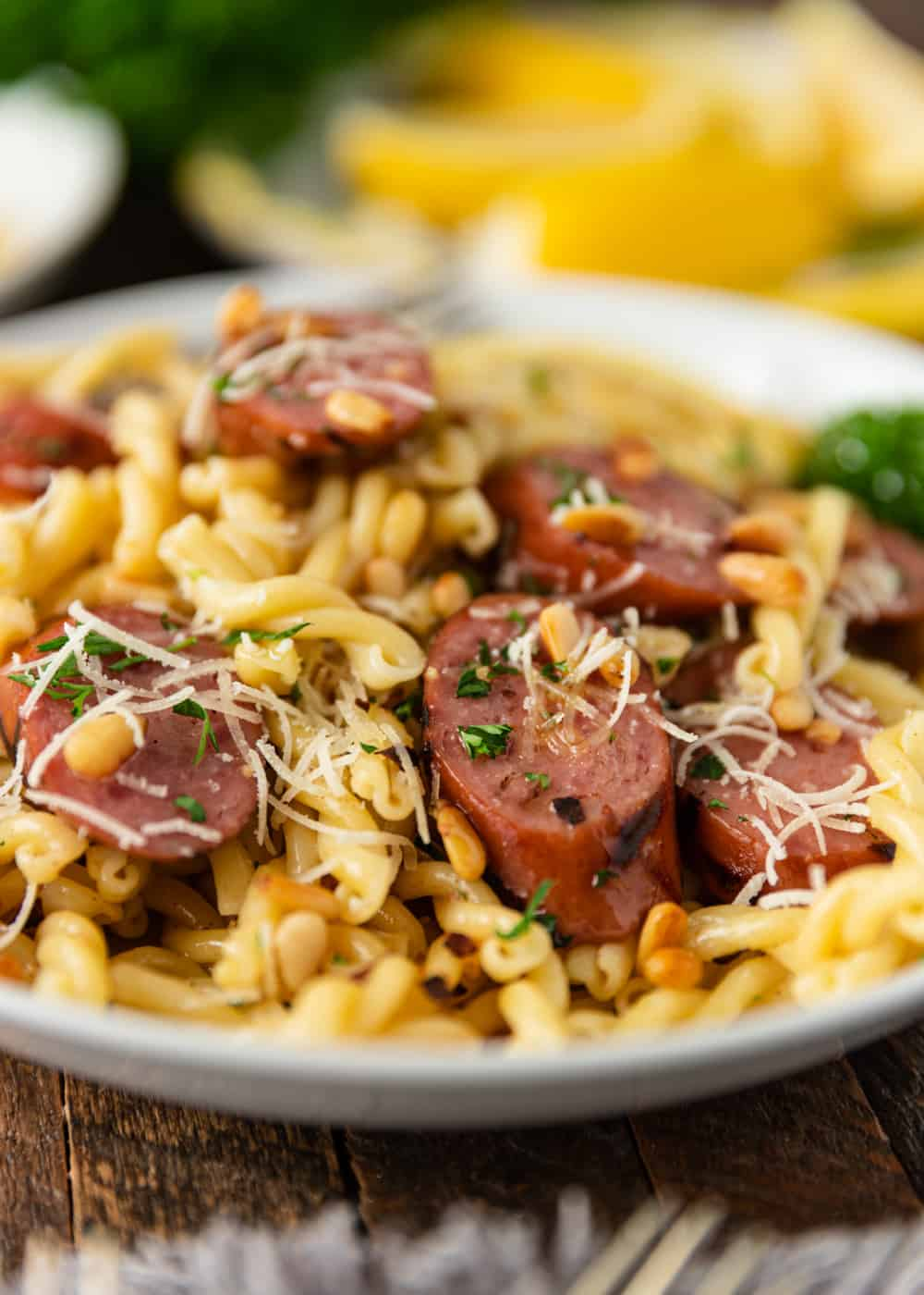 close up of sliced sausage with pasta
