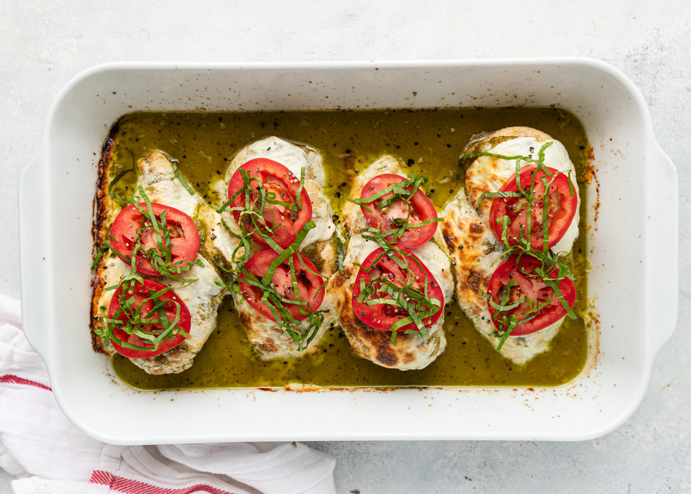 white casserole dish of Baked Chicken Caprese