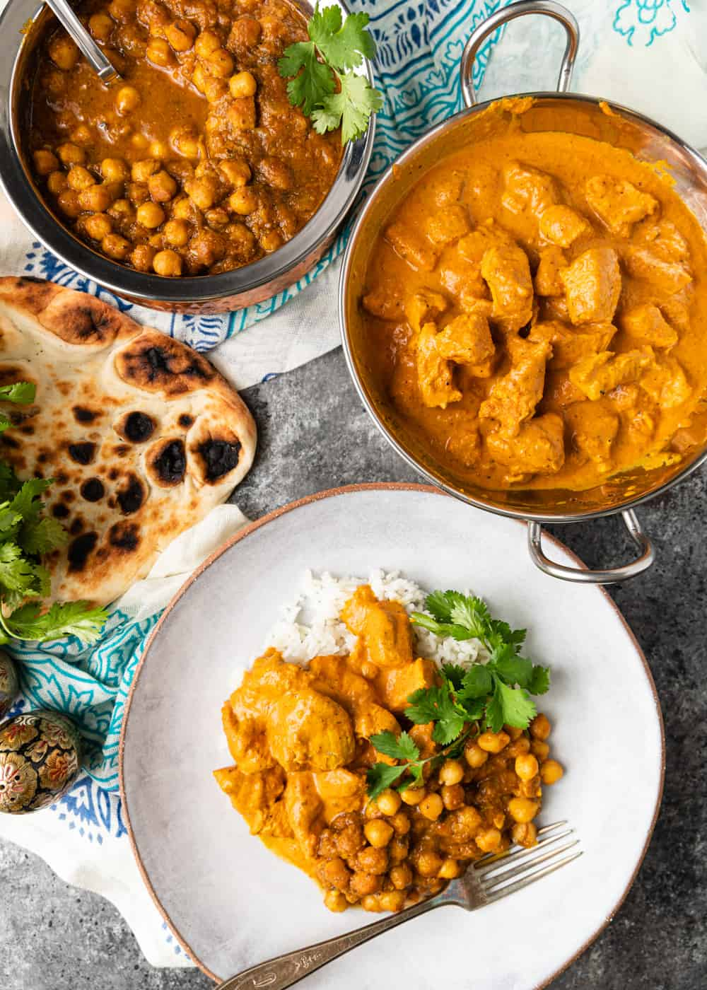 plate of butter chicken with chana masala