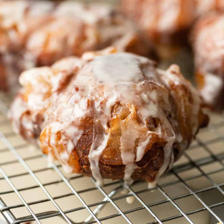 close up of a glazed apple fritter