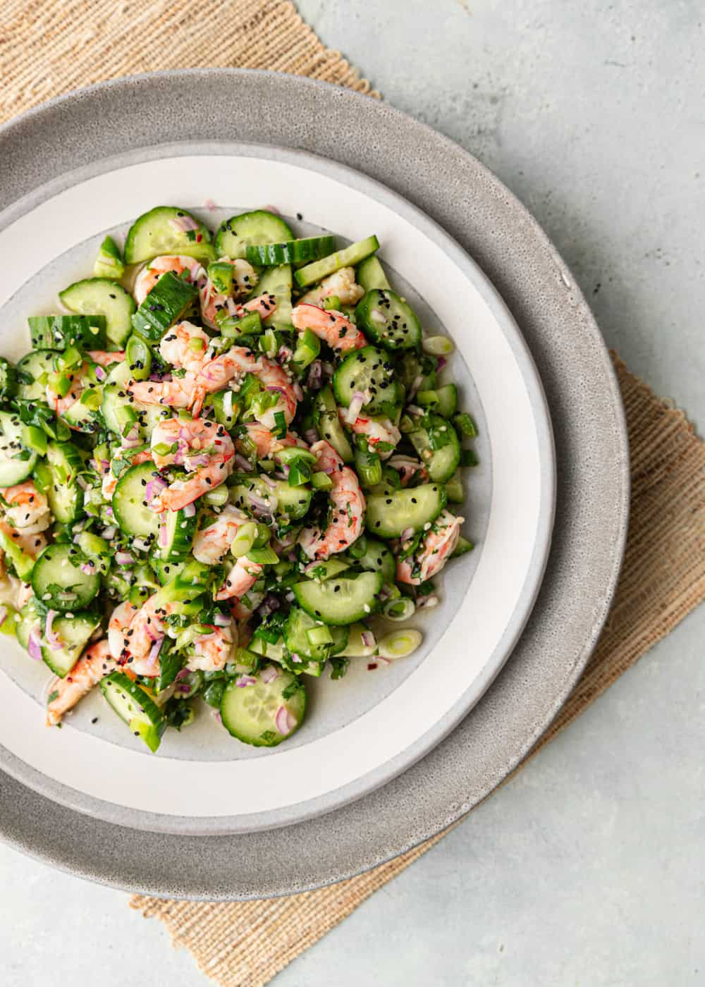 overhead photo of a shrimp cucumber salad on plate