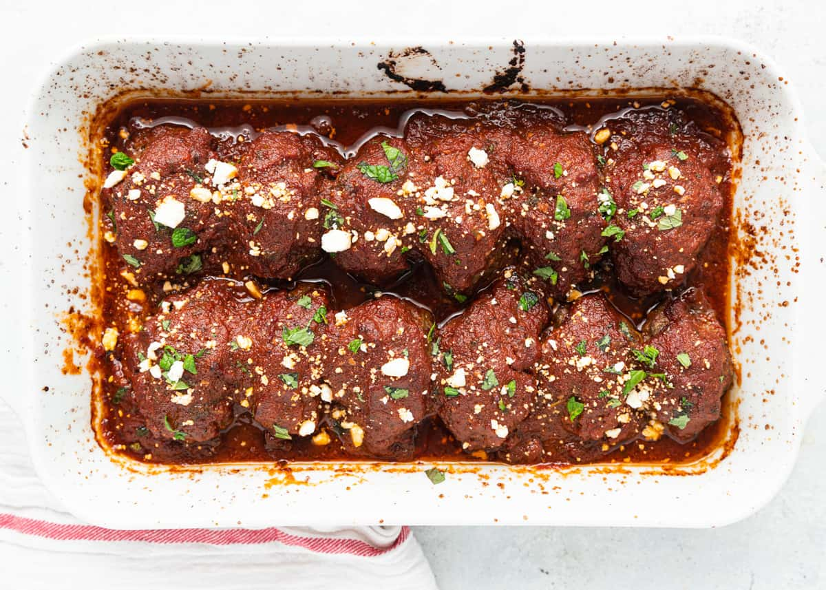 completed dish of baked meatballs with sauce in rectangle baking dish