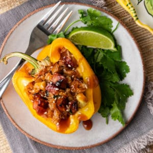 Hawaiian stuffed pepper on a grey plate